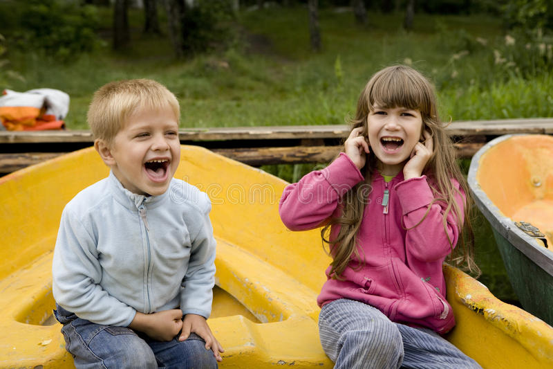 Download Friendship. Kids Playing In Boat Stock Photo - Image of attractive, forest: 10177320