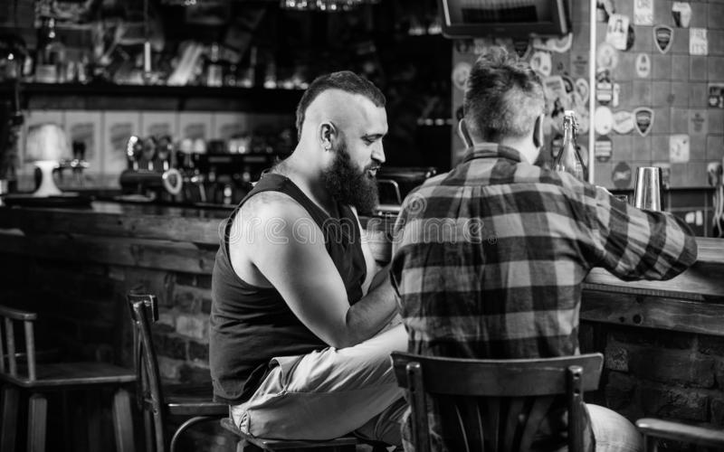 Friendship and leisure. Friday relaxation in bar. Friends relaxing in pub. Hipster brutal bearded man spend leisure with. Friendship and leisure. Friday royalty free stock images