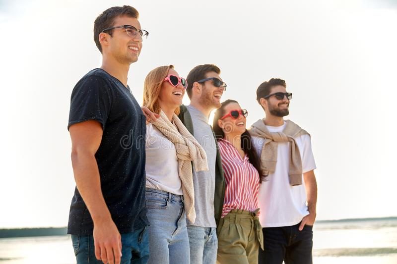 Happy friends on summer beach stock photography