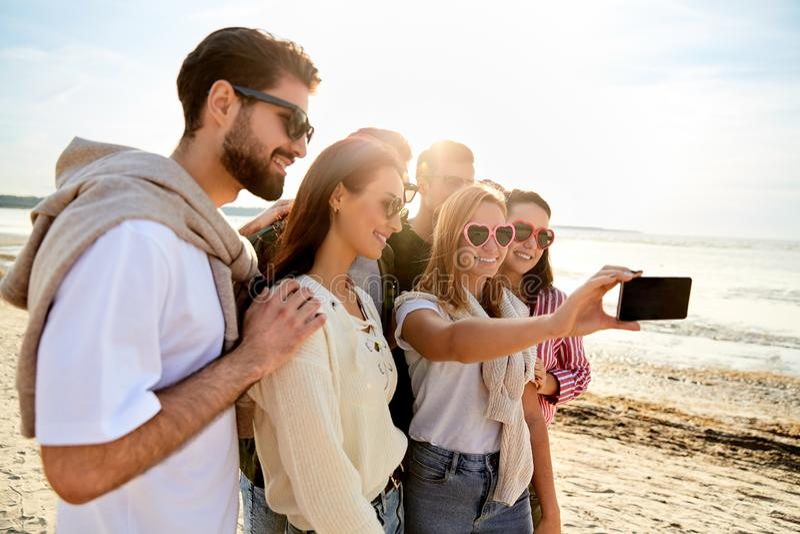 Happy friends taking selfie in summer stock images