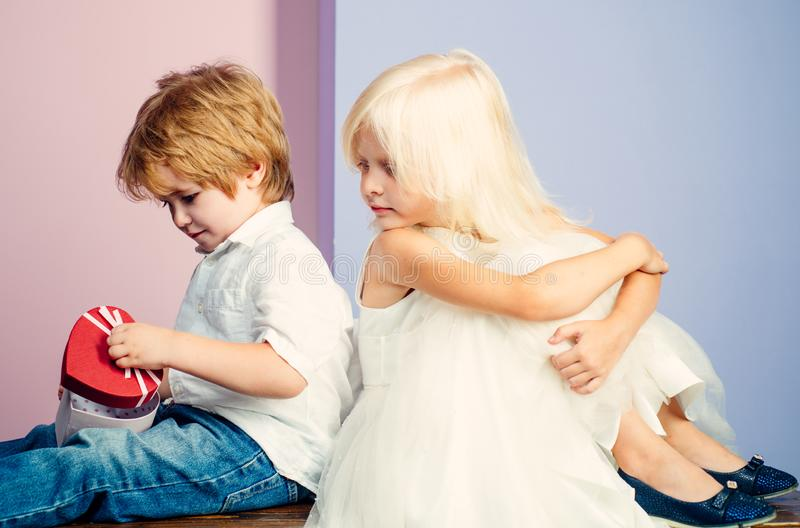 Friendship and love. Lovely tender children. Small kids friendship. Sincere friendship. Couple adorable kids white stock image
