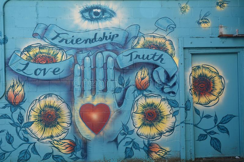 Friendship, Love, Truth Mural in Corvallis, Oregon. This is the Friendship, Love, Truth Mural in an alley in Corvallis, Oregon royalty free stock photography