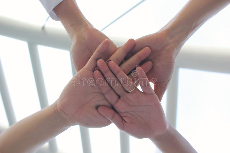 Friendship,Meeting teamwork concept,Group people with stack of hands showing unity on natural green background royalty free stock images