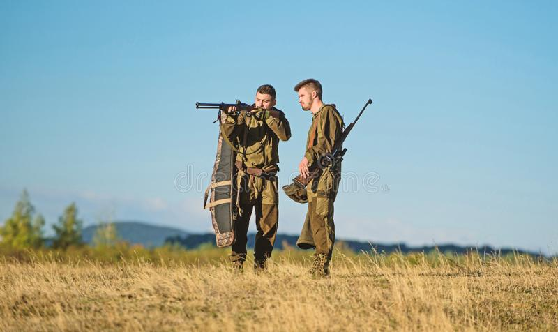 Friendship of men hunters. Military uniform fashion. Army forces. Camouflage. Hunting skills and weapon equipment. How. Turn hunting into hobby. Man hunters stock images