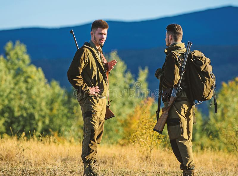 Friendship of men hunters. Military uniform fashion. Army forces. Camouflage. Hunting skills and weapon equipment. How. Turn hunting into hobby. Man hunters royalty free stock photography