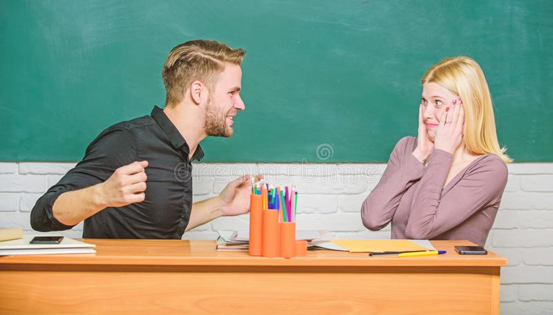 Friendship and relations. Compromise solution. College relations. Relations with classmates. Students communicate. Classroom chalkboard background. Education stock image
