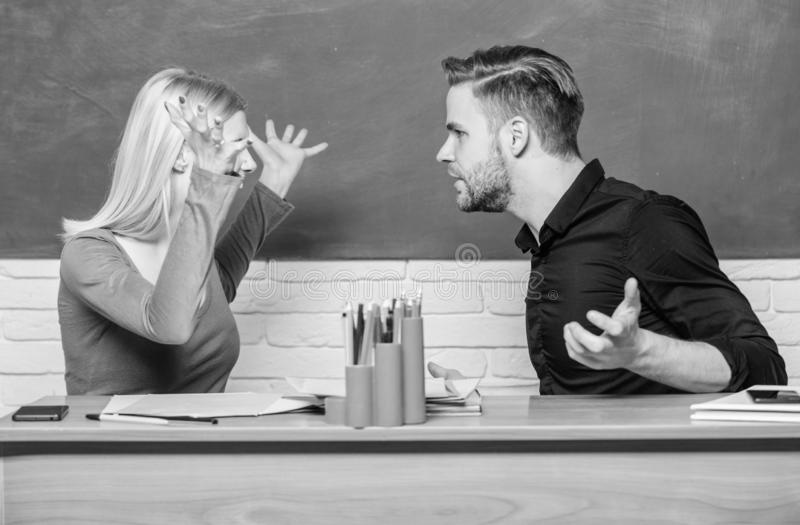 Friendship and relations. Compromise solution. College relations. Relations classmates. Students communicate classroom. Chalkboard background. Violence and stock photos