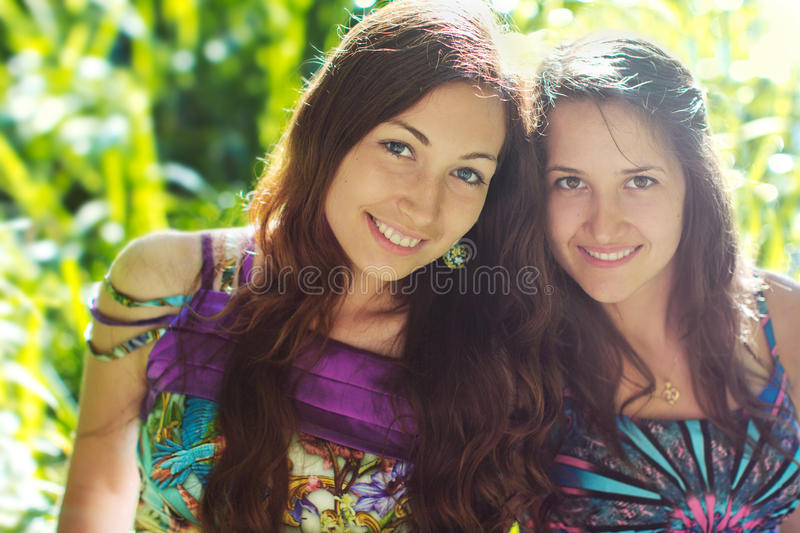 Friendship smiling two girls royalty free stock image