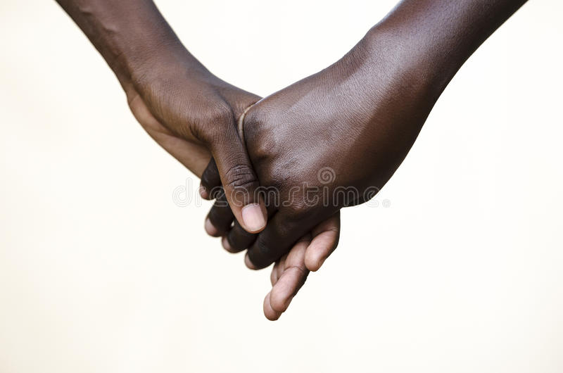 Friendship Symbol: Black People Holding Hands Together stock photography