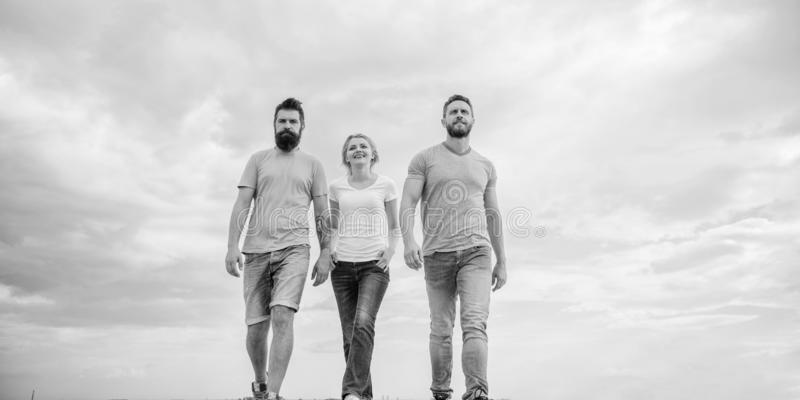 Friendship tested for years. United threesome true friends. Men and woman walks dramatic cloudy sky background. True. Friendship tested for years. United royalty free stock photos