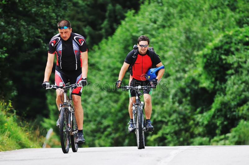 Download Friendship And Travel On Mountain Bike Stock Image - Image: 11003613
