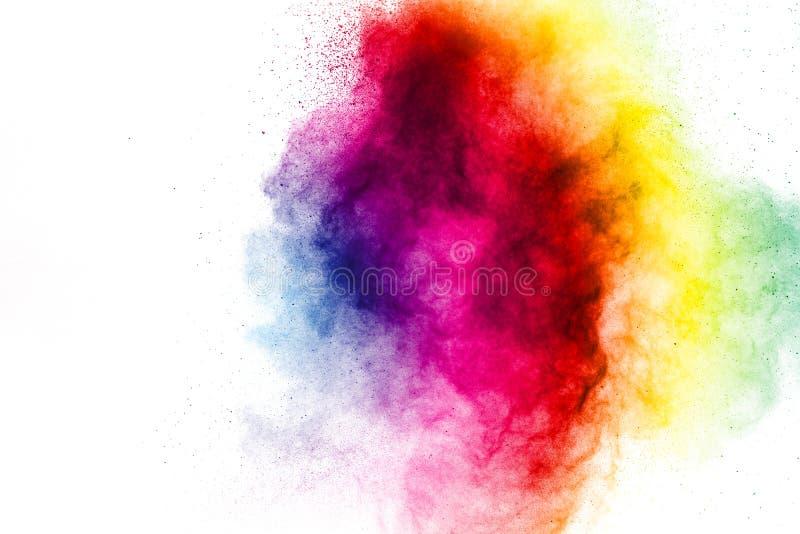 Frieren Sie Bewegung von den farbigen Pulverexplosionen ein, die auf weißem Hintergrund lokalisiert werden stockbilder