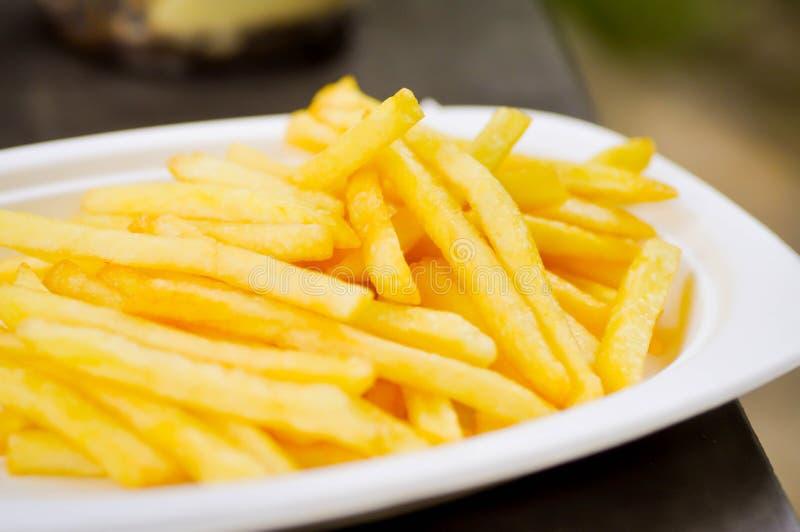 Frieten, gebraden aardappel stock afbeeldingen