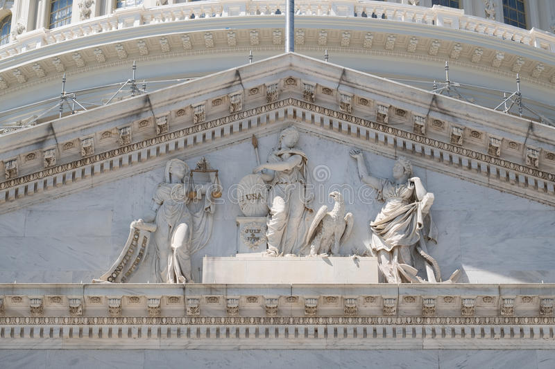 Frieze of the US Capitol at Washngton D.C. With statue commemorating the US Independence royalty free stock images