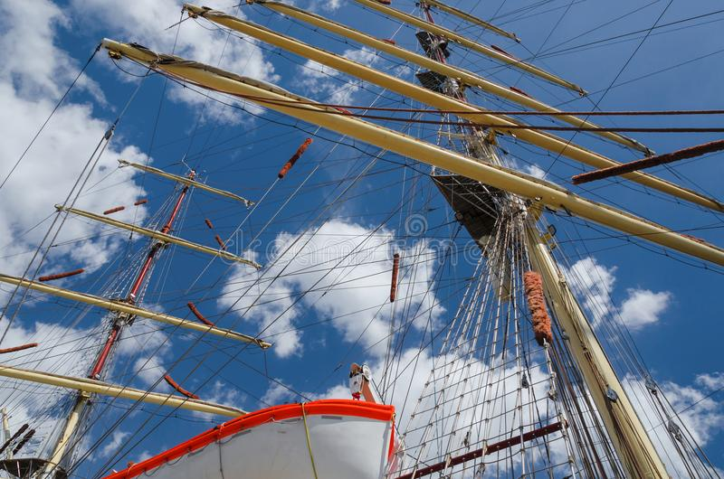 FRIGATE. Masts of a sailing ship against the sky stock photography