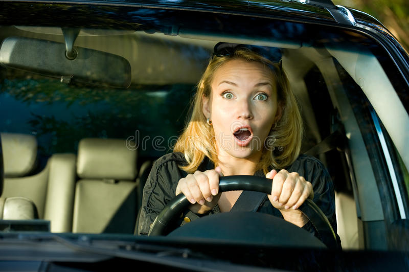 Fright Face Of Woman Driving Car Stock Image
