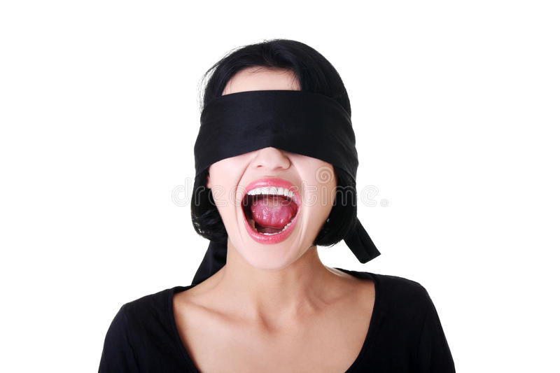 Frighten young blindfold woman screaming stock image