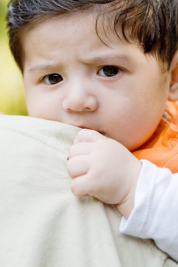 Frightened baby boy stock photography