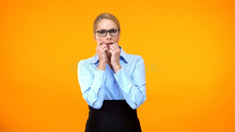 Frightened business woman looking around, company worker panicking, stress royalty free stock images