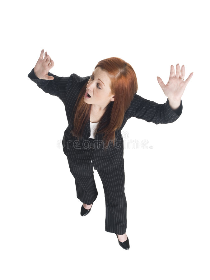 Frightened businesswoman. Looking over shoulder and running away, white background royalty free stock images