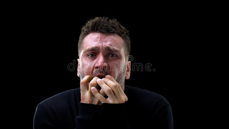 Frightened caucasian man remembering horrible past, psychological trauma, health. Stock photo stock images