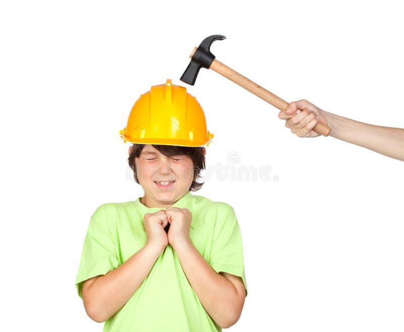Frightened child with yellow helmet