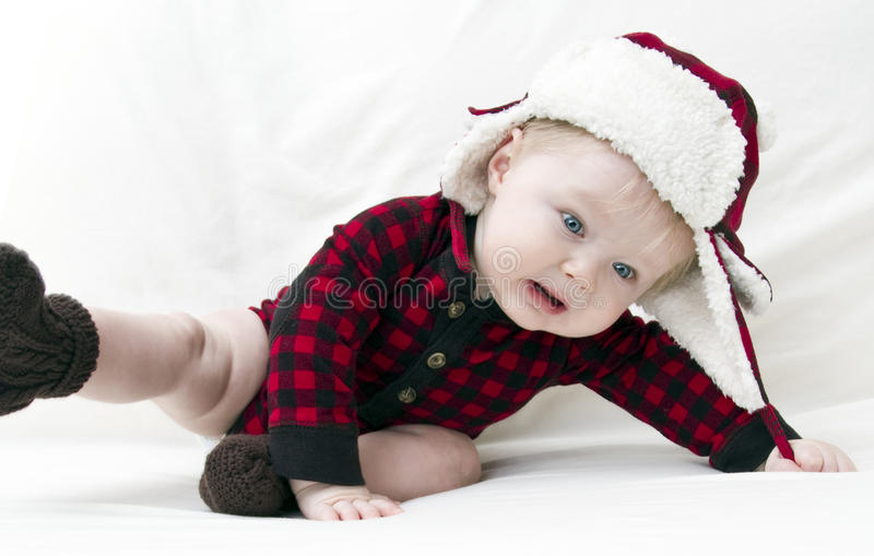 Frightened Christmas baby falling over stock photos