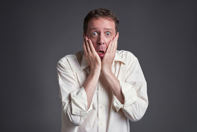 Frightened man. Middle age man feeling frightenedr royalty free stock images