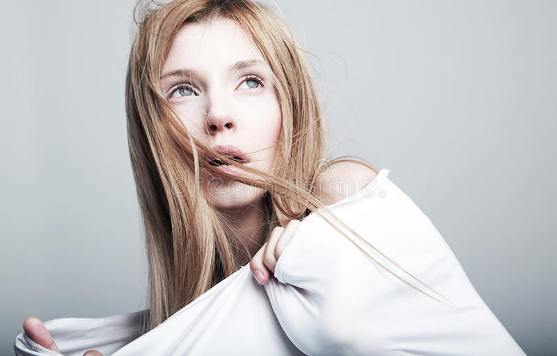 Frightened pretty young girl in white. Nightmare - Frightened lovely woman blonde in white clothes stock images