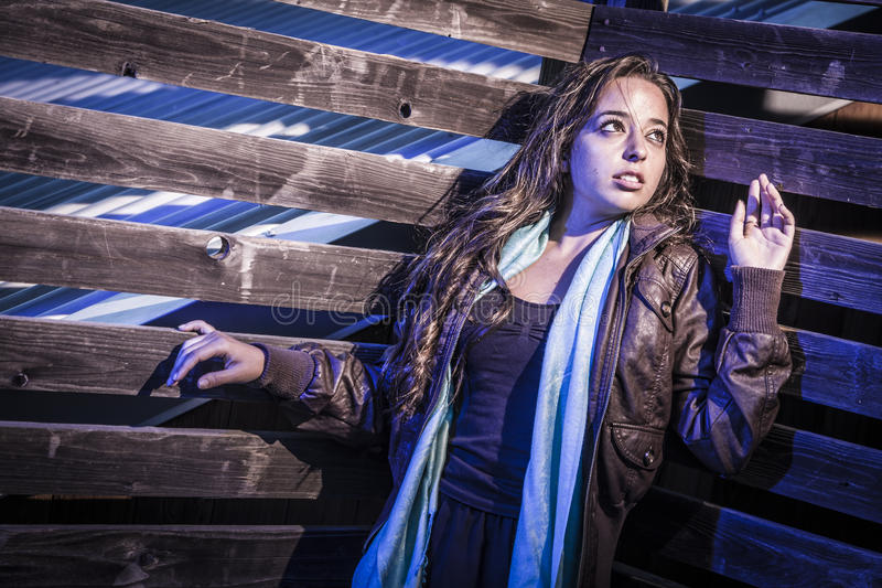 Frightened Pretty Young Woman in Dark Walkway at Night stock photography