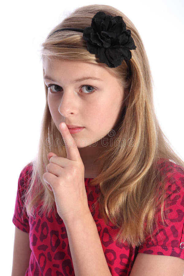 Download Frightened School Girl Child Makes Keep Quiet Sign Stock Photo - Image: 21101286