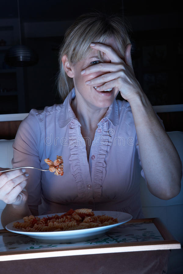 Download Frightened Woman Enjoying Meal Watching TV Stock Photo - Image of film, dinner: 18746136