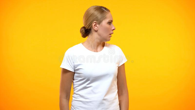 Frightened woman looking right on bright background, fear expression, anxiety royalty free stock photos