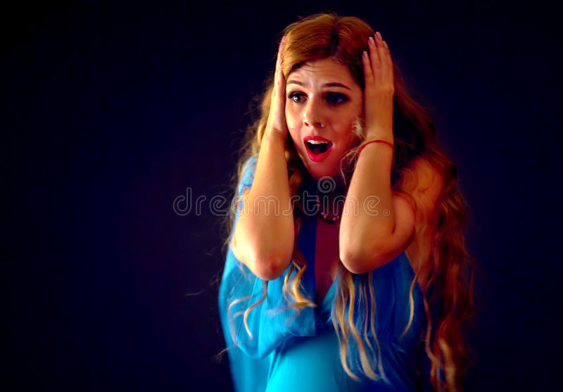 Frightened woman screaming with fear indoor at halloween night. royalty free stock photo