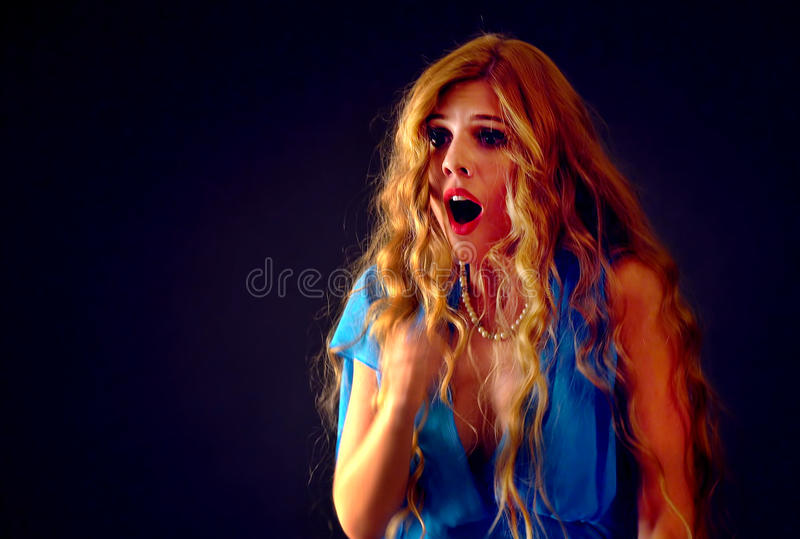 Frightened woman screaming with fear indoor at halloween night. stock photo