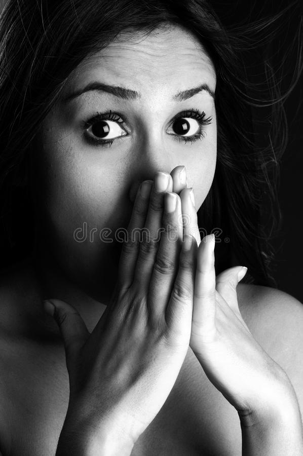 Frightened young woman royalty free stock images