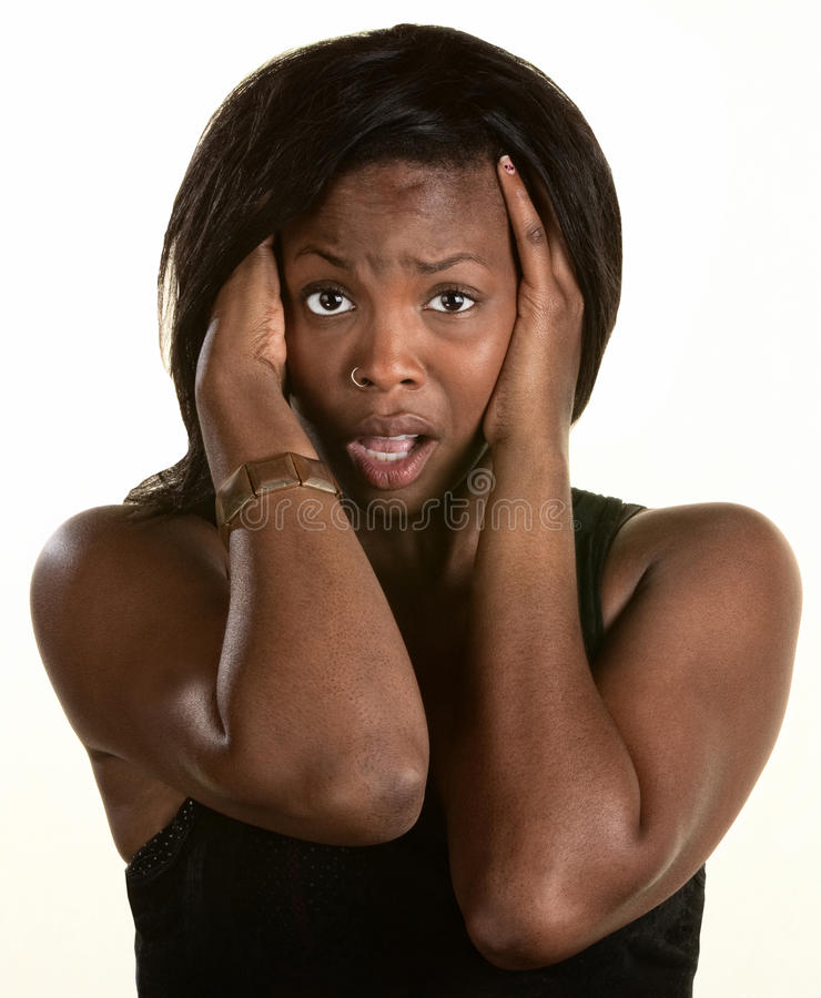 Frightened Young Woman. Frightened Black woman with hands on head royalty free stock photos