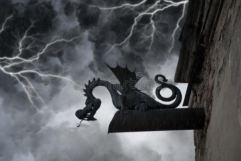 Frightening chimera on the facade of the old castl stock images