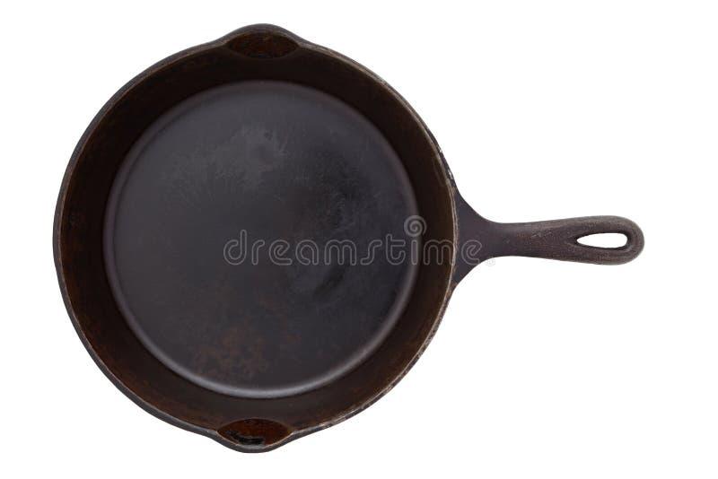 Frigideira do ferro fundido isolada no branco foto de stock royalty free