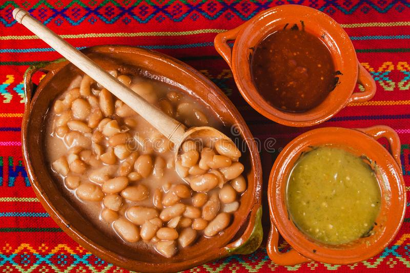 Frijoles, soup of beans mexican food, mexico city. Frijoles or soup of beans with red and green sauce mexican food, mexico city stock photography