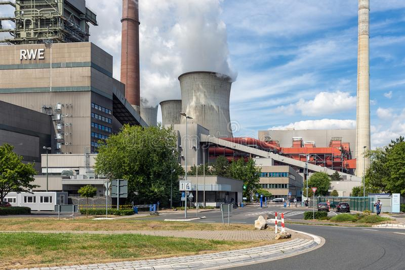 Workers leaving factory gate coal-fired power plant Frimmersdorf in Germany stock photos
