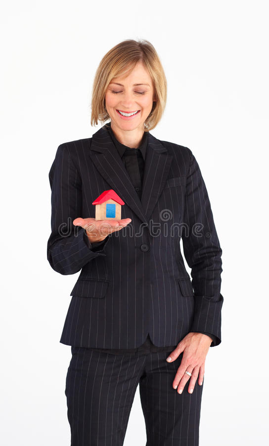 Download Frinedly Mature Businesswoman Holding A House Stock Image - Image: 10428241
