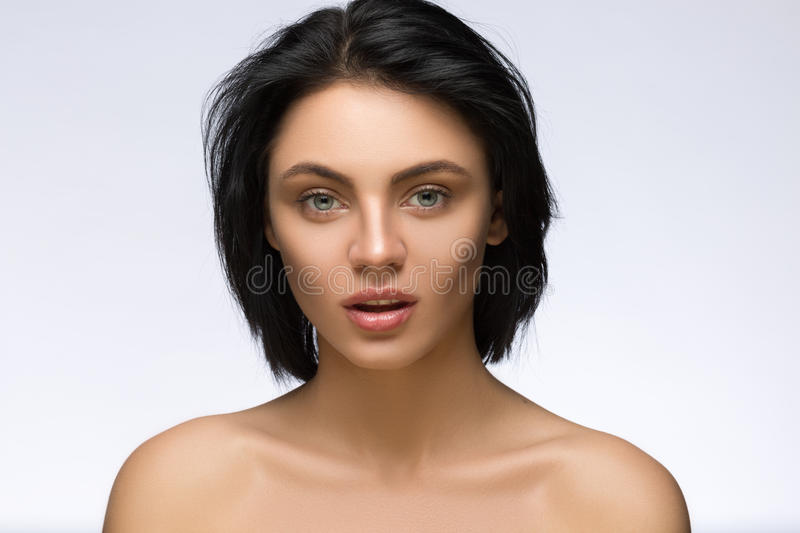 Fringe. Fashion Model Girl With Trendy Hairstyle. Haircut. Stylish Beauty Brunette Woman Face. Beautiful Make up. Vogue. Style. Hair cut. Perfect Skin royalty free stock photography