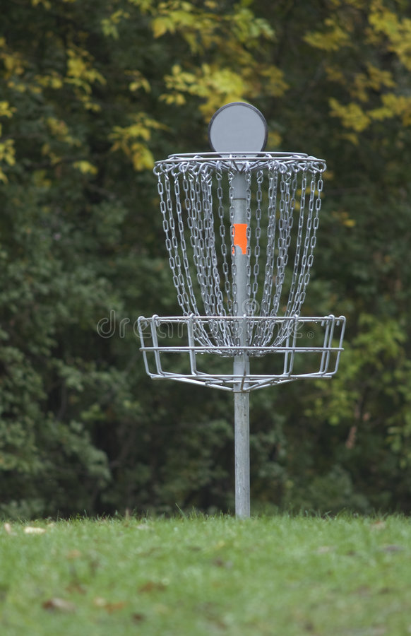 Frisbee Golf Basket. Photograph of a pole hole on a frisbee golf course royalty free stock image