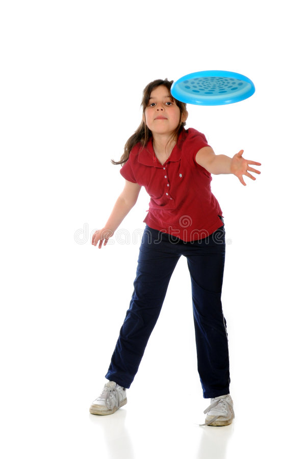 Frisbee Toss. An elementary girl throwing a blue frisbee. Isolated on white stock image