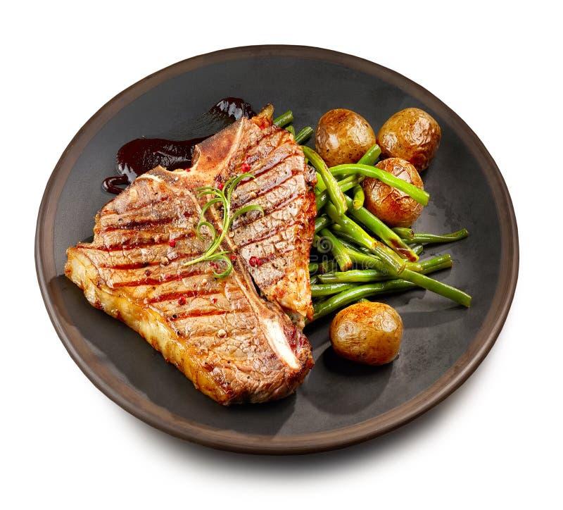 Frisch gegrilltes Steak des förmigen Knochens stockfotos