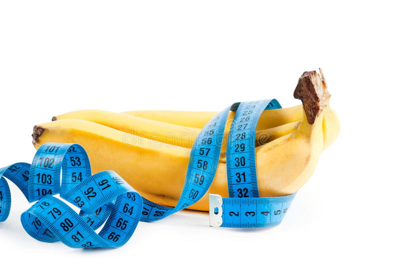 Frische Banane und messendes Band lizenzfreie stockfotografie