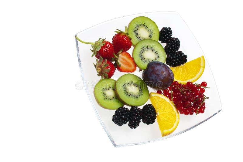 Frische Frucht auf weißer Platte stockbild
