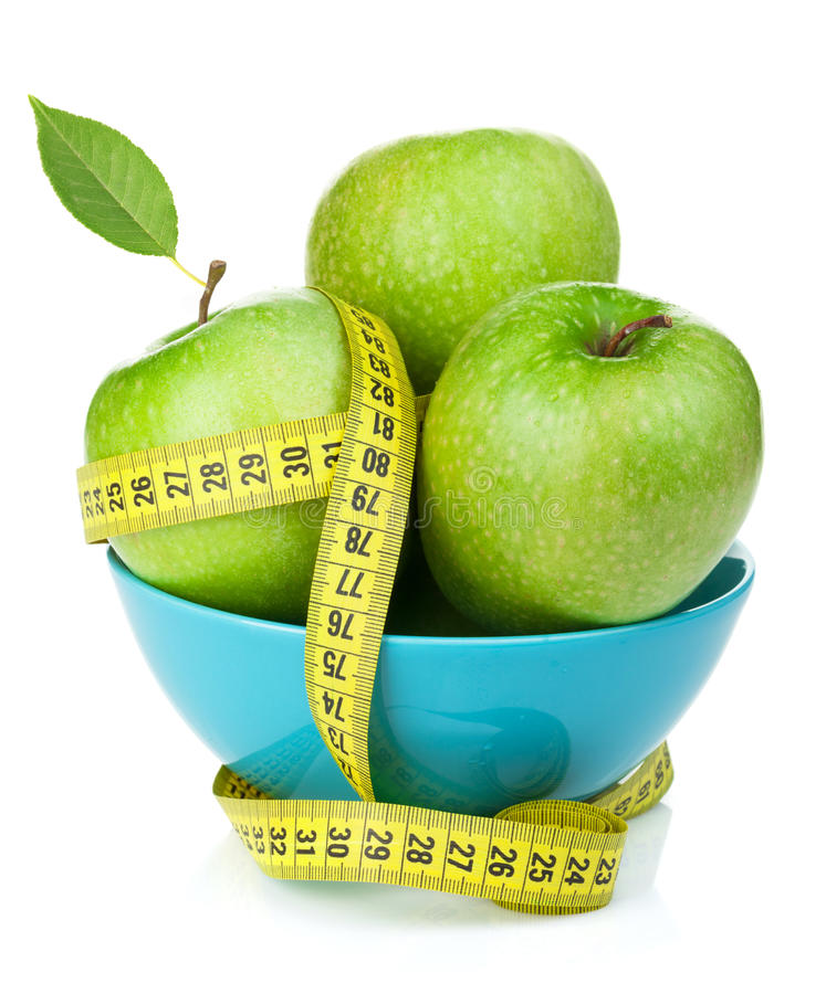 Frische grüne Äpfel mit gelbem messendem Band lizenzfreies stockbild