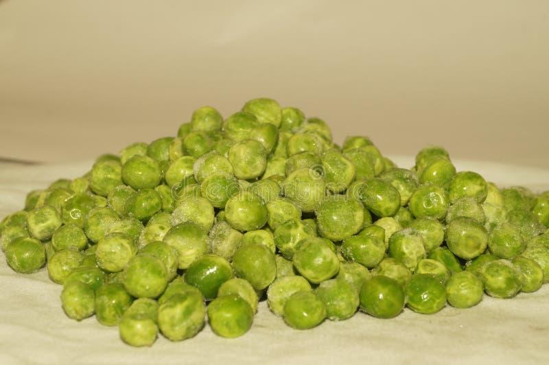 Frische grüne Erbsen/murmeln HD-Bild stockfotografie